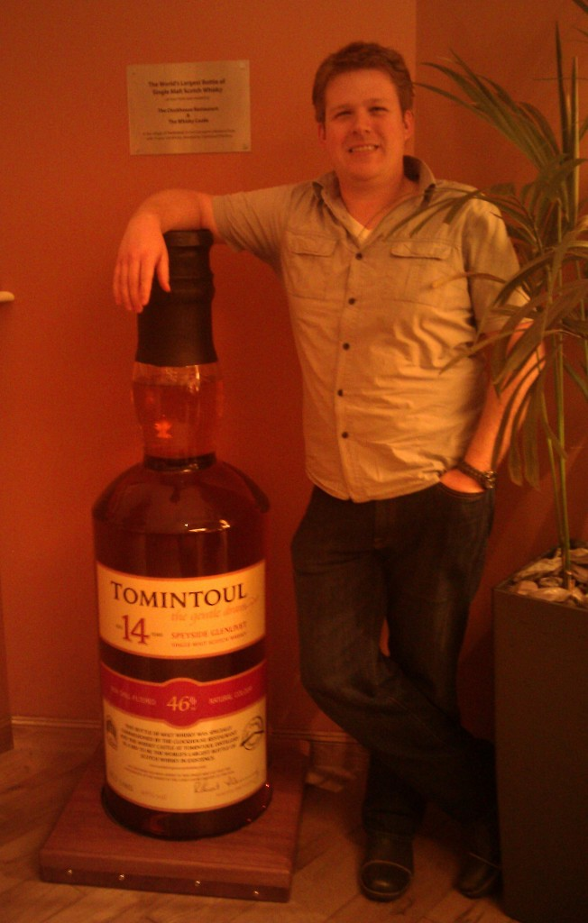 The largest bottle of scotch in the world, as depicted in the most awkwardly-posed picture in the world.  Sorry, the Internets.  Please don't make a meme out of me.